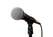 Vocal microphone with cord on a stand closeup isolated Royalty Free Stock Photography