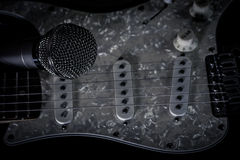 Vocal microphone and electric guitar Stock Photos