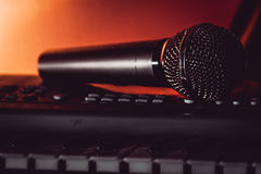 The vocal microphone piano keys Royalty Free Stock Images
