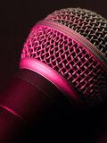 Vocal microphone in pink light Stock Image