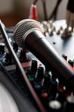 Vocal microphone on sound mixer Royalty Free Stock Image