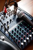 Vocal microphone on sound mixer Royalty Free Stock Images