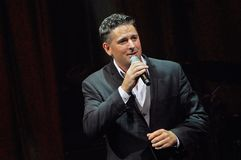 Male vocalist singing onstage stock photo