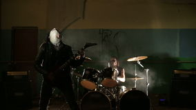 Vocalist and drummer of black metal band at dark background stock video footage