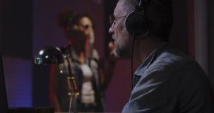 Vocalist and sound engineer working in studio