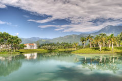 Vocation. Concept of villa with lake and grassland in sunny day Stock Photography