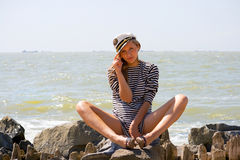 Vocation. A young girl on the seashore, summer Stock Photo