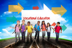 Vocational education against railway leading to blue sky. The word vocational education and elementary pupils running against railway leading to blue sky Royalty Free Stock Images