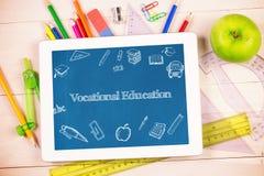 Vocational education against students desk with tablet pc. The word vocational education and education doodles against students desk with tablet pc stock illustration