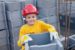 Vocational guidance concept. Boy at construction site Royalty Free Stock Images