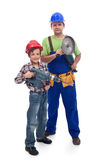 Vocational guidance concept. Boy with manual worker holding power tools, isolated royalty free stock images