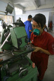 Vocational school. Students are practices using the lathe in the city of Solo, Central Java, Indonesia Royalty Free Stock Photography