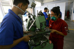 Vocational school. Students are practices using the lathe in the city of Solo, Central Java, Indonesia Stock Images