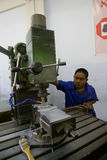 Vocational school. Students are practices using the lathe in the city of Solo, Central Java, Indonesia Stock Image