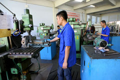 Vocational school. Students are practices using the lathe in the city of Solo, Central Java, Indonesia Royalty Free Stock Photo