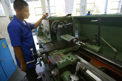 Vocational school. Students are practices using the lathe in the city of Solo, Central Java, Indonesia Royalty Free Stock Photos