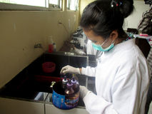 Vocational student. S currently practice in chemical laboratory in the city of Solo, Central Java, Indonesia Stock Image