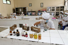 Vocational student. S doing chemistry lab in the city of Solo, Central Java, Indonesia stock photo