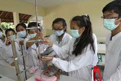 Vocational student. S doing chemistry lab in the city of Solo, Central Java, Indonesia Stock Image