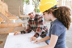 Vocational Training - Blueprints. Vocational education student learning to read construction blueprints Royalty Free Stock Images