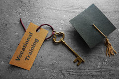 Vocational Training concept. Vocational Training key tag with graduation cap royalty free stock photos