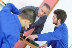 Vocational training with two students. Vocational royalty free stock image