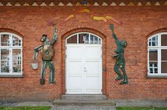 Vocational university in the Danish town Jelling. Entrance with figures of painters in the vocational university of the Danish town Jelling royalty free stock image