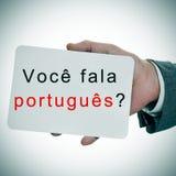 Voce fala portugues ?您讲在portugue写的葡萄牙语 免版税库存照片