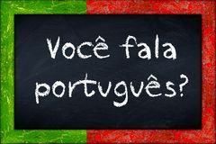 Voce fala portugues blackboard with portugal flag frame Stock Photography
