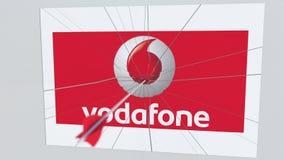 VODAFONE λογότυπο επιχείρησης που χτυπιέται από το βέλος τοξοβολίας Εννοιολογική εκδοτική ζωτικότητα επιχειρησιακής κρίσης απεικόνιση αποθεμάτων