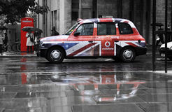 Vodafone advertisement on a black cab. Vodafone advertisement on a a black cab in London, UK stock photo