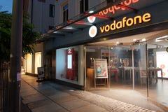 Vodafone på natten Arkivfoton