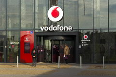 Vodafone telecommunications company logo on Czech headquarters. PRAGUE, CZECH REPUBLIC - NOVEMBER 7: Vodafone telecommunications company logo on Czech stock photos