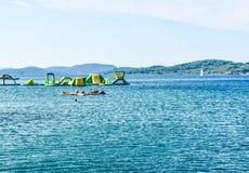 The Vodice beach, Croatia. The group at aqua yoga classes royalty free stock image