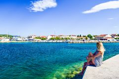 The Vodice cityscape. Girl on the background of Vodice cityscape, Croatia royalty free stock photos