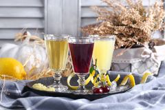 Vodka in assortment on a kitchen table with ingredients Stock Photography