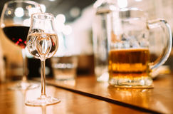 Vodka , beer and red wine glasses on the restaurant table. Royalty Free Stock Photo