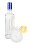Vodka bottel and glass. Vodka glass bottle and lemon isolated on white background stock image