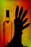 Vodka bottle and kitchen knives Stock Images