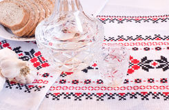 Vodka in decanter, bread and garlic Royalty Free Stock Photo