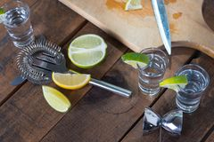 Vodka drinks with lemon and lime Stock Photos