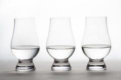 Vodka en tres Crystal Tasting Glasses Fotografía de archivo