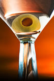 Vodka or gin martini with olive. Close view of a vodka or gin martini with olive in a clear glass Stock Photo
