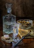 Vodka in glass with salted mushrooms and bakon on black bread Royalty Free Stock Photos