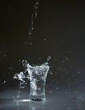 Vodka glass with splashes Royalty Free Stock Photo