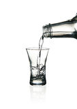 Vodka glass with splashes stock images