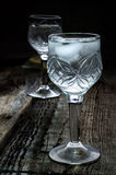 Vodka. A glass of vodka on a wood background Stock Photography