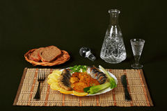 Vodka and herring. The herring is fine snack to the cooled vodka Stock Photography