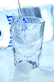 Vodka & ice. Glass with vodka and ice cubs Royalty Free Stock Image