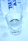 Vodka & ice. Glass with vodka and ice cubs Stock Photography